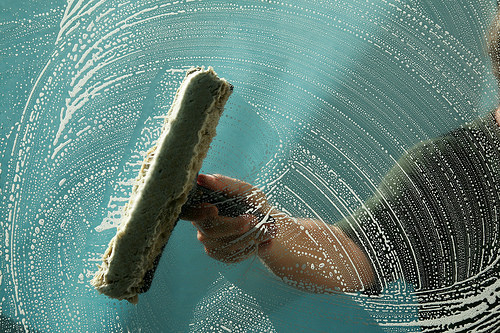 photo credit: a window washer soaps up a window for window washing via photopin (license)